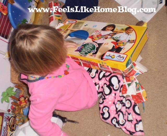 A little girl opening Christmas presents