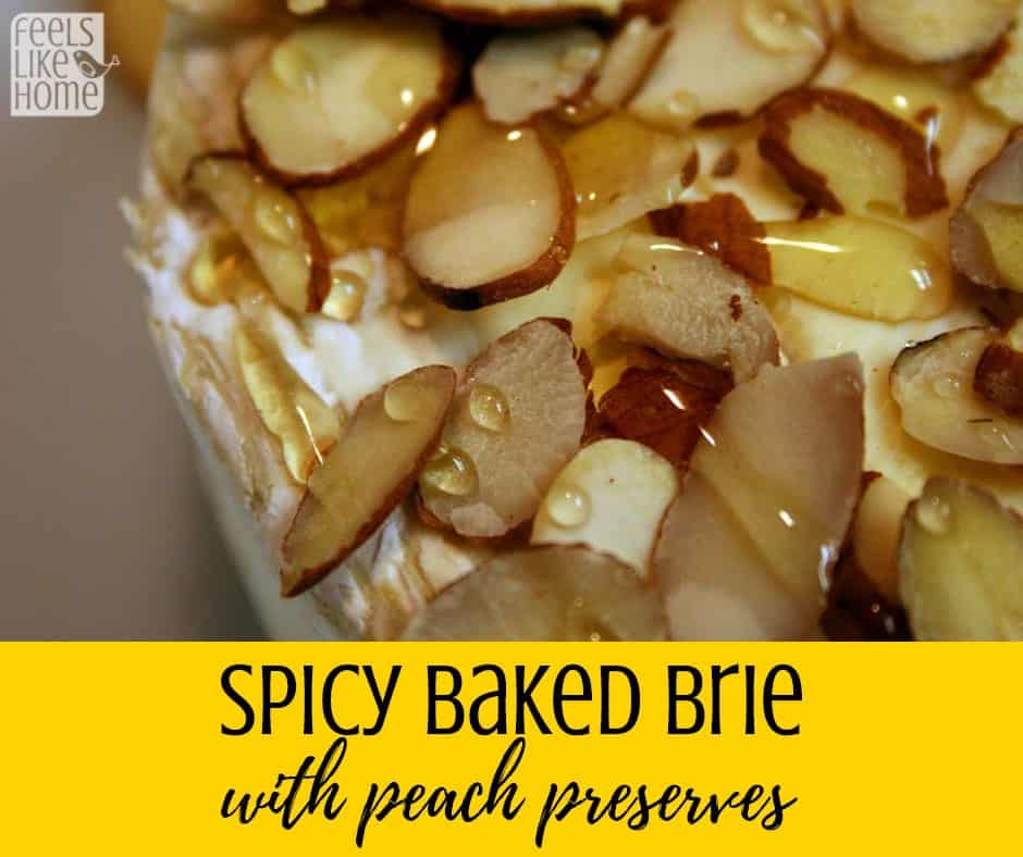 Best spicy baked brie recipe with peach jam - This super simple and easy recipe is the perfect sweet and savory appetizer for Thanksgiving, Christmas, or any occasion! Includes almonds or pecans as a topping.