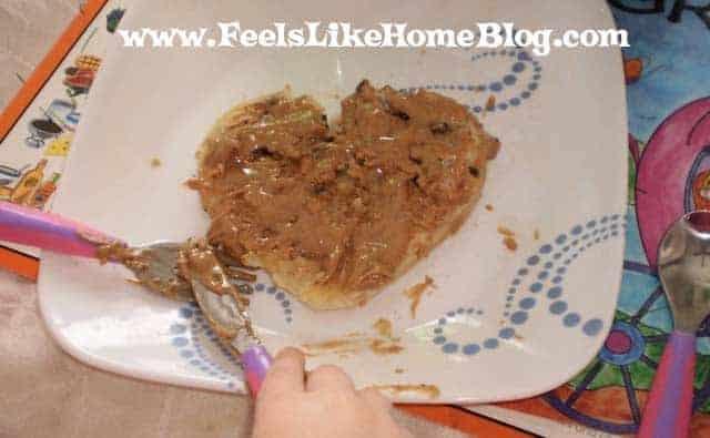 A child eating a heart pancake