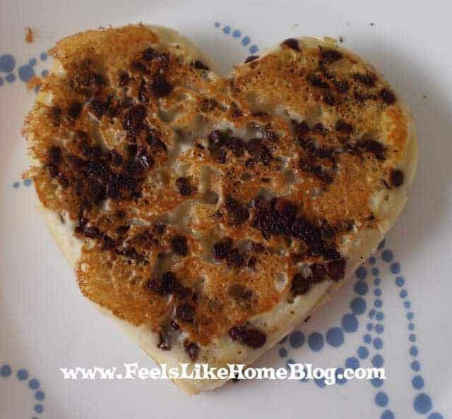 how to make heart-shaped pancakes with a metal cookie cutter - These DIY chocolate chip pancakes are as delicious as they are pretty! They are a fun way to have breakfast for Valentine's Day or any day of the year. Breakfast in bed for Mom on Mother's Day would be nice too! Perfect for kids and families. Top with peanut butter, fruit, or maple syrup.
