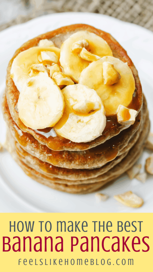 a stack of pancakes on a white plate with bananas and walnuts