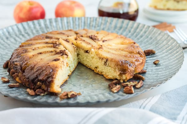 a baked apple pecan pancake with one slice out