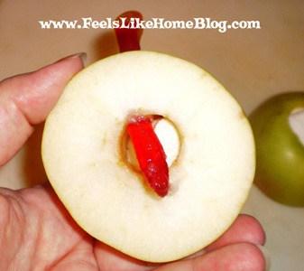 gummi worm in wormy apple snack