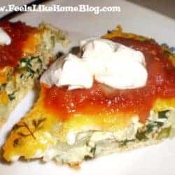 A close up of an oven omelet with salsa and sour cream