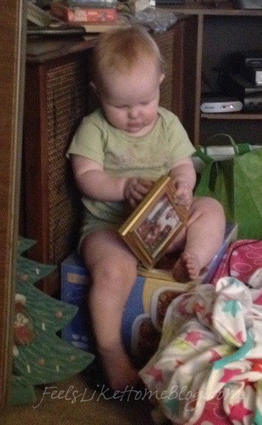 A dirty baby looking at pictures