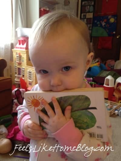 A baby chewing on a book