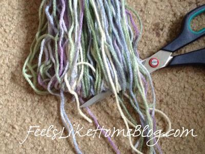 Cut the bottom of the yarn loops