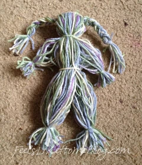 Divide the remaining yarn in half and tie a knot in each half for legs