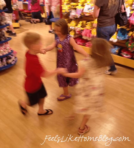 A group of kids dancing at Build A Bear Workshop
