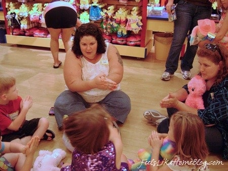 A mom playing on the floor with the kids