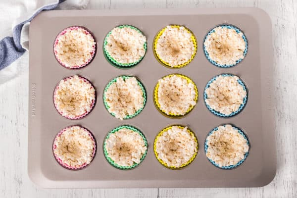 A muffin pan full of Rice Krispies treats