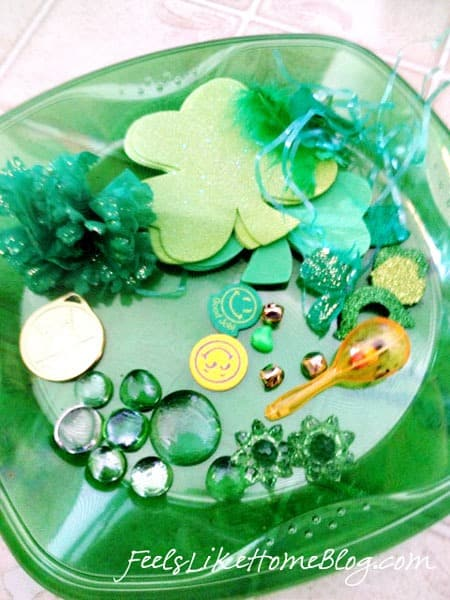 A close up of a green plate, with small objects