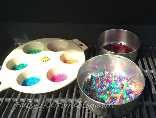 How to make melted bead suncatchers in the oven or gas BBQ grill - Fun, easy activity ideas for DIY gifts made by kids and adults. We used these beautiful projects as Mother's Day gifts but they would also make nice baby mobiles or wind chimes or Christmas ornaments. Can be made any shape including hearts depending on what kind of cake pan or muffin tin you use. Perfect summer crafts.