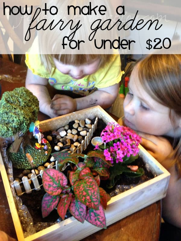 Two little girls looking at a fairy garden