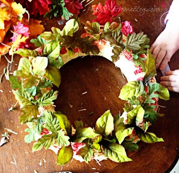 Glue on green leaves first - Autumn Wreath Craft for Kids
