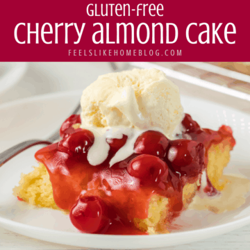 A piece of cherry almond cake topped with ice cream