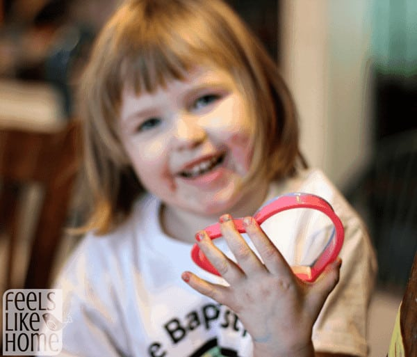 Allie's big smile with her cookie cutter painting