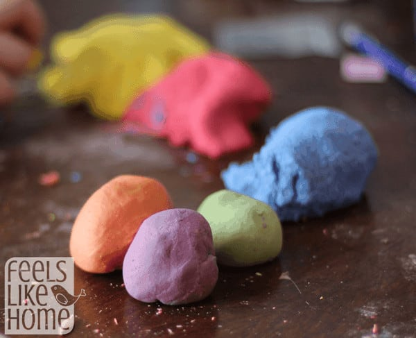 A close up of homemade play dough in many colors