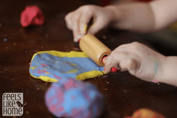 Rolling play dough mixing colors