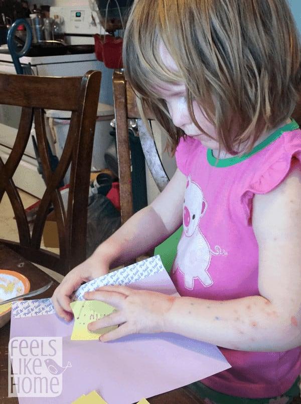 Teaching a preschooler to write a letter