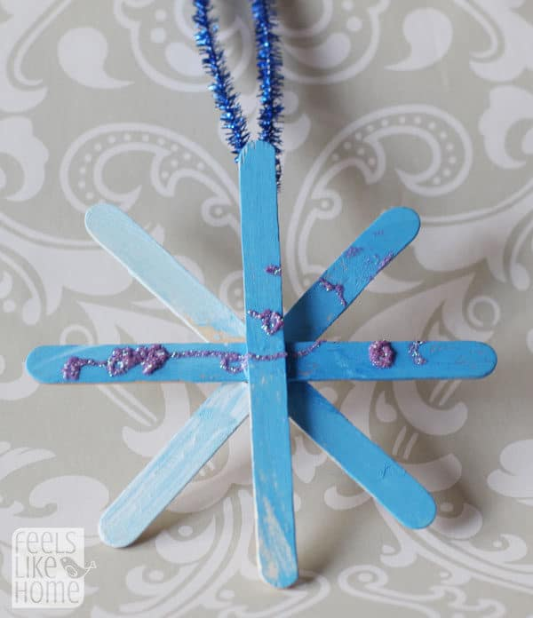 A blue snowflake made of popsicle sticks