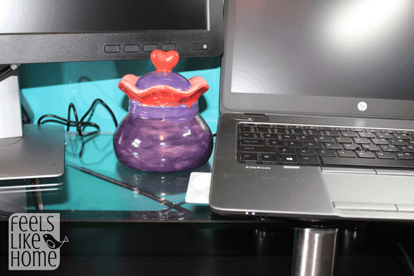 A laptop computer sitting on top of a desk