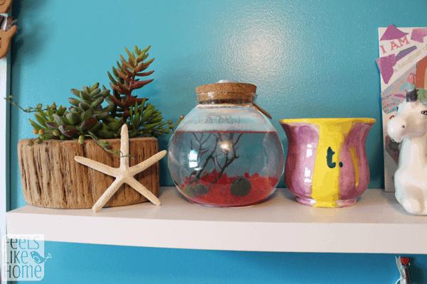 A shelf with starfish and mug