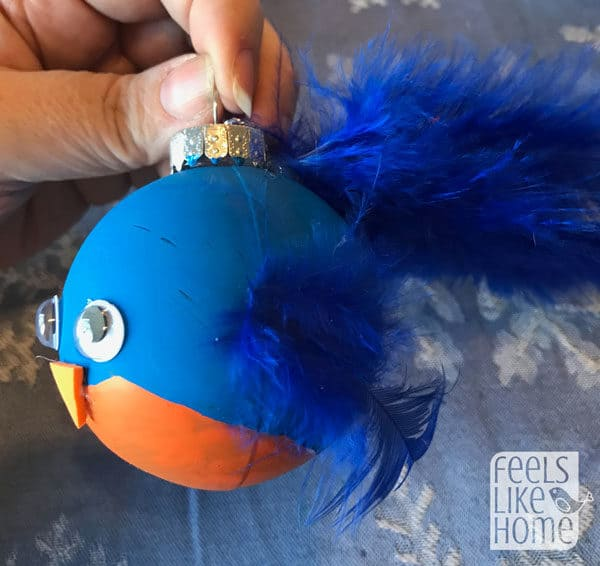 Blue bird ornament with orange belly