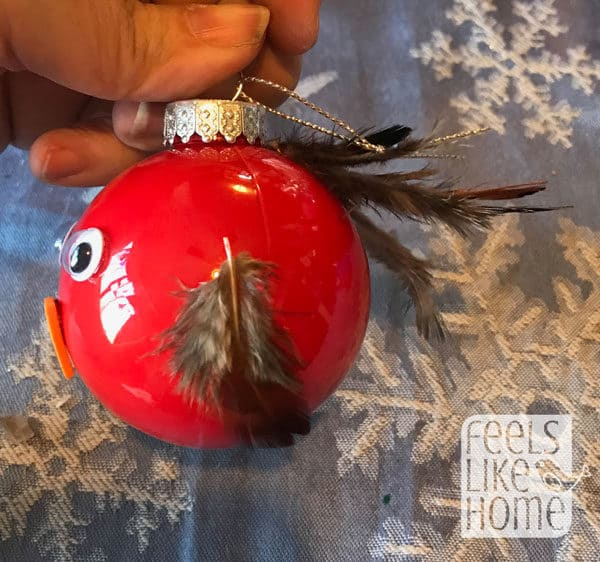Red bird ornament with brown feathers
