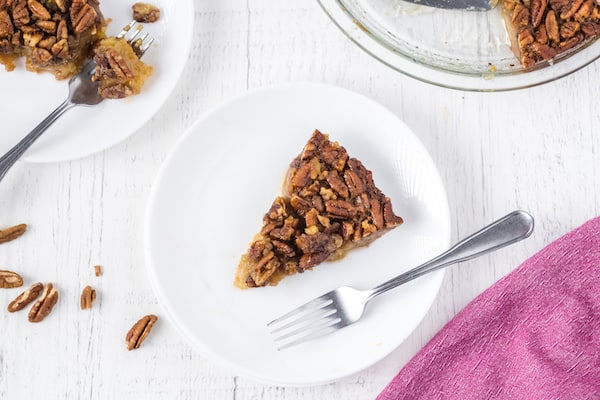 A slice of crustless pecan pie on a plate