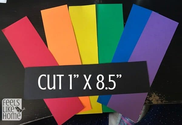 Cut strips of rainbow colored paper