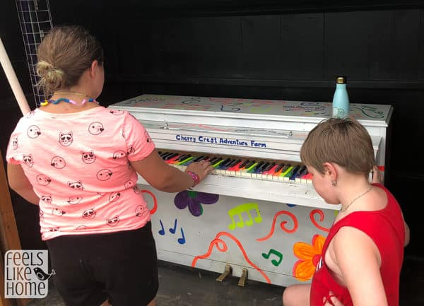 Kids playing a piano