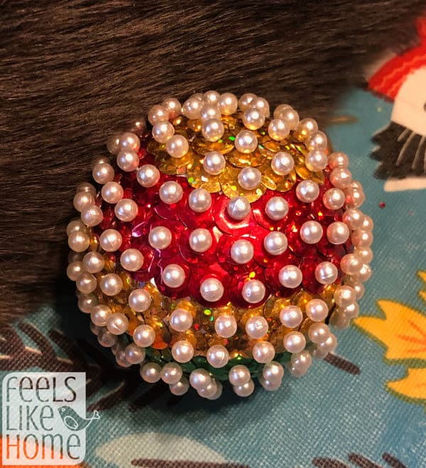finished Christmas ornament covered with sequins and pins