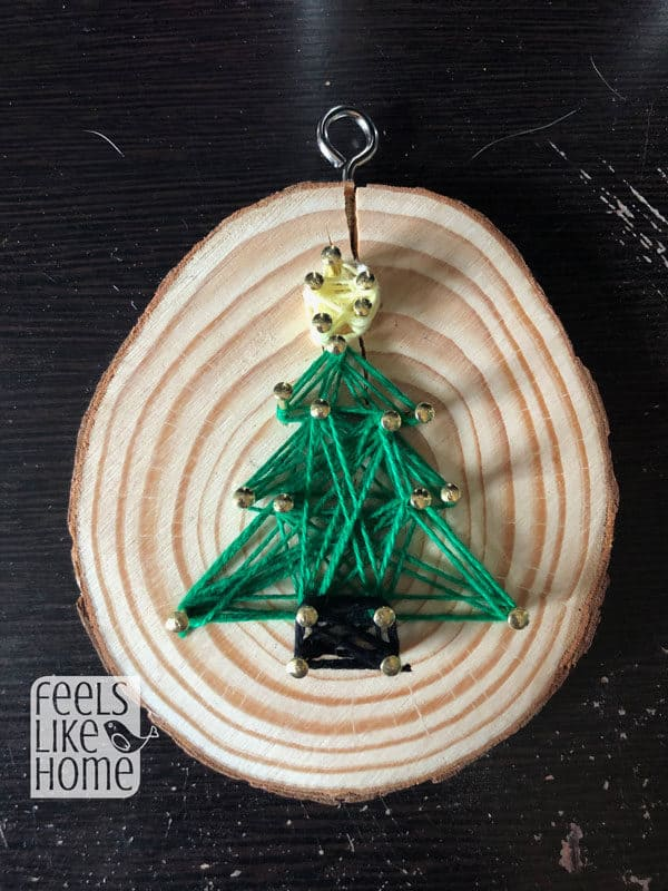 A closeup of the Christmas tree string art