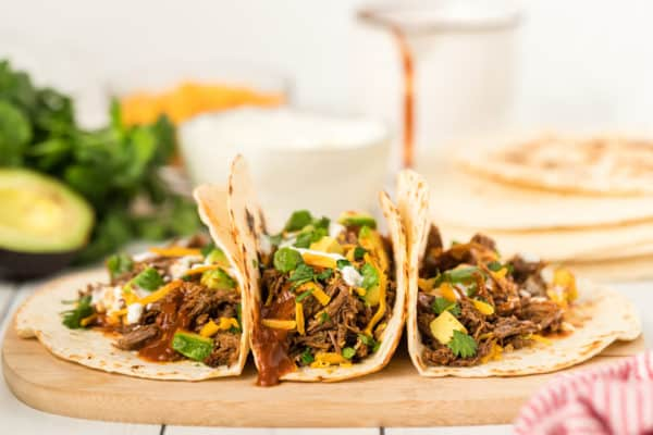 A plate of shredded beef tacos