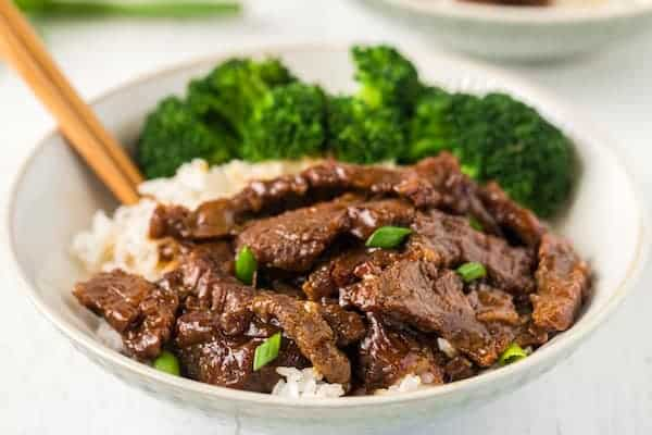 finished Mongolian beef served with broccoli and rice