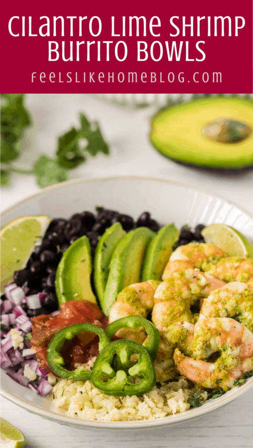 A burrito bowl with shrimp, avocado, black beans, jalapeños, salsa, onions, and a wedge of lime