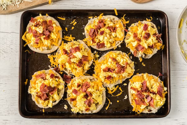 add crumbled bacon on top of the eggs