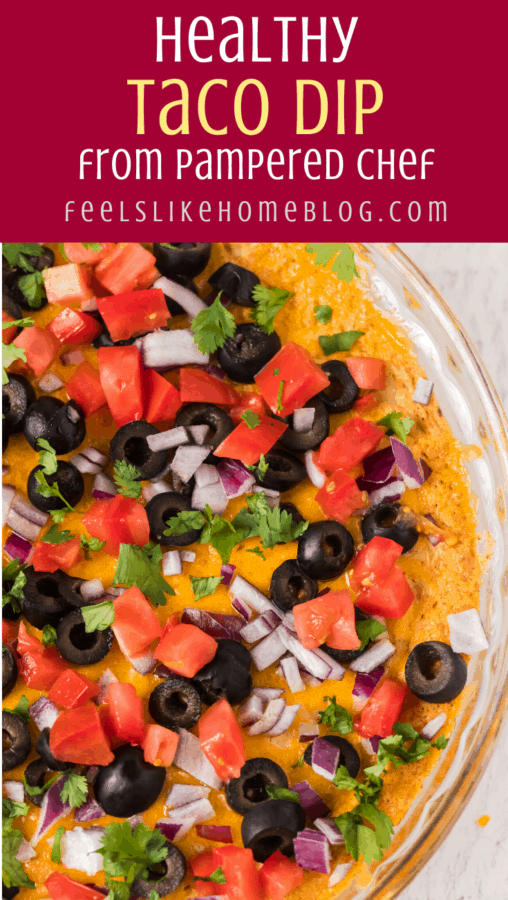 A close up of taco dip with toppings