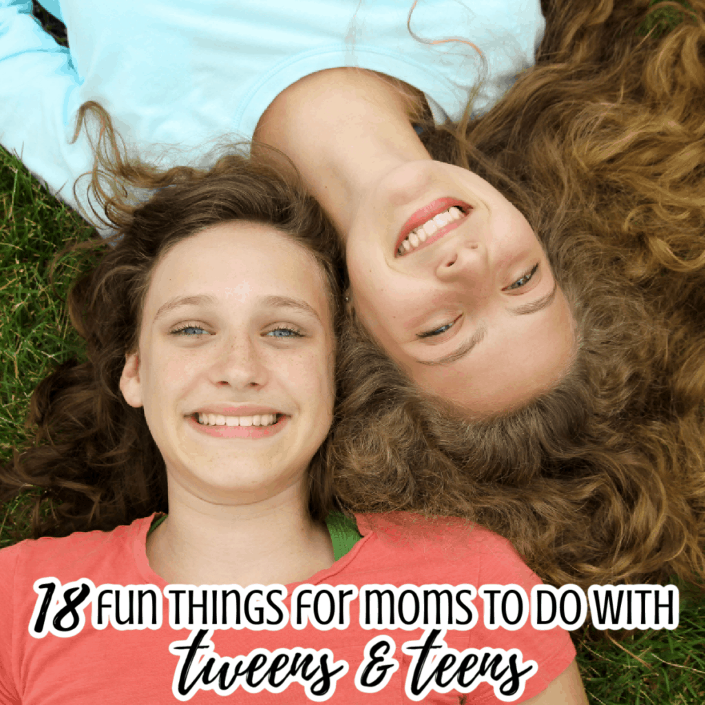 2 teen girls laying in the grass